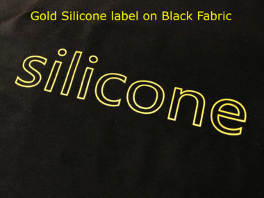 Gold Silicone Label on Black Fabric